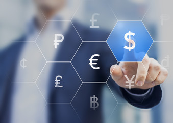 Businessman presenting currencies on virtual screen and touching