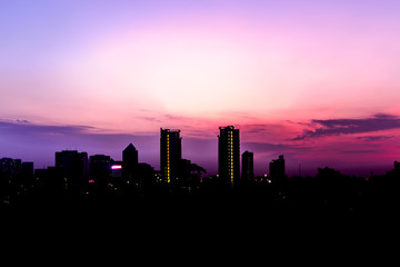 Silhouette of Bangkok cityscape at sunset, Thailand.