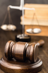 Wooden gavel with scales and books