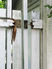 White painted wood fence in need of renovation