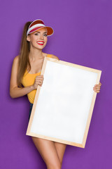 Sexy Woman Holding A White Picture