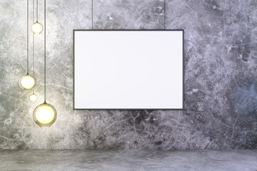 Blank picture frame with lightbulbs on concrete wall with concre