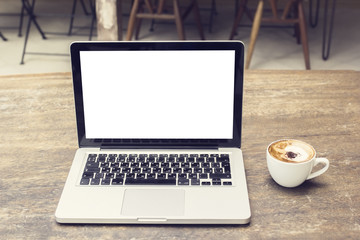 Blank screen of laptop with cup of coffee on a wooden table, moc