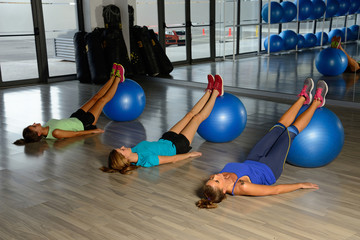 Young women exercising in a gym.