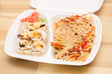 Chinese noodles and Japanese rolls in box