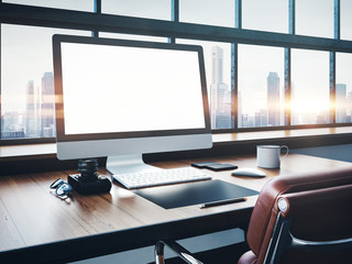Photo of classic workspace with panoramic windows.  City at sunrise in the background. 3D rendering