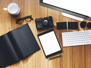 Photo of modern workspace with desktop screen, tablet, camera, keyboard, book. Top view.  3D rendering