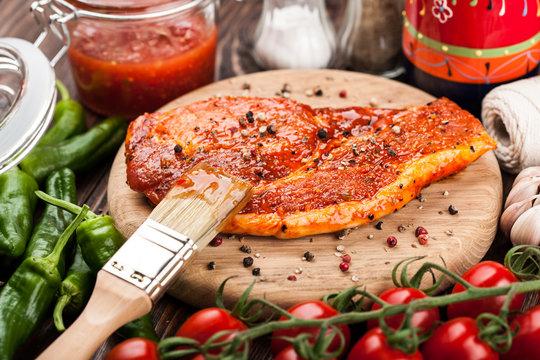 Marinated pork steak on cutting board