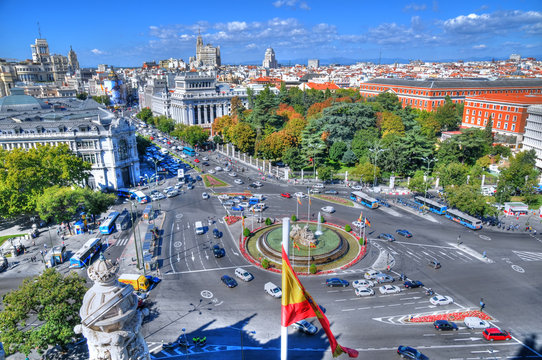 MADRID, SPAIN, OCT 5: traffic at Plaza de Cibeles as can be seen from the top of the Cybele Palace (City Hall),  in HDR in Madrid, Spain, Oct 5, 2015
