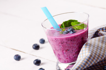 Blueberry shake on white table