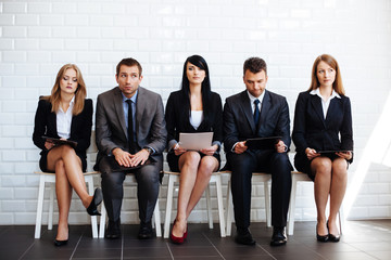 Confidence is crucial. Business people before job interview