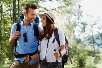 Happy backpackers couple hiking Wall mural