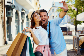 Couple taking selfie in the city