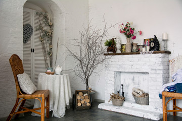 The design interior rustic room with a fireplace, flowers, chair