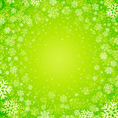 Christmas background of snowflakes in green colors