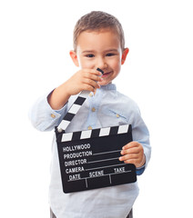 portrait of a little boy holding a clapper board
