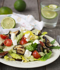 Salad with grilled eggplant, tomatoes and feta cheese