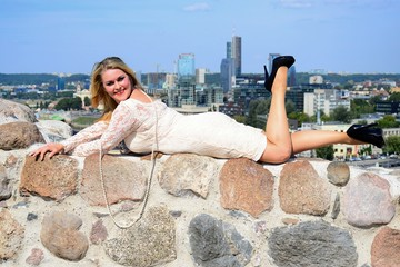 Beautiful girl in Vilnius town on Gediminas castle hill