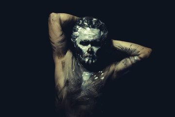 Dance, wild man with white painted face and full body black pain