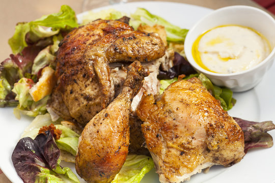 crispy free-range rotisserie chicken on organic butterleaf salad