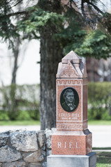 Louis Riel grave under old tree, founder of the province of  Manitoba and leader of the Metis  in St. Boniface Cathedral Cemetery, Winnipeg, Manitoba