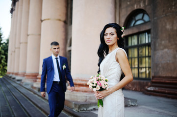 the bride and groom  with a wedding bouquet on the background of