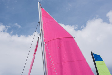 Two colorful  sails of sailboats