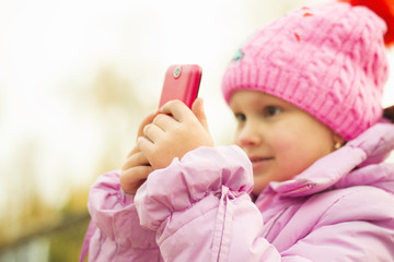 little girl in the park with your phone