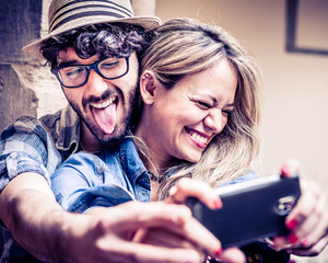 Funny Selfie, Couple of Hipsters Having Fun with Smartphone Phot