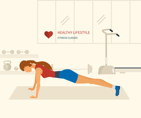 Young adult woman push-up  from the floor in fitness gym