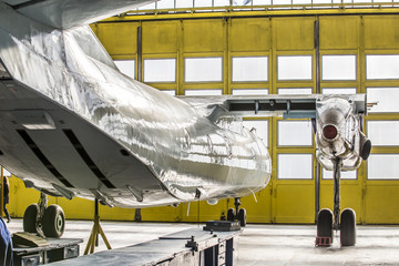 Wall Mural - Аirplane on service in hangar without wing