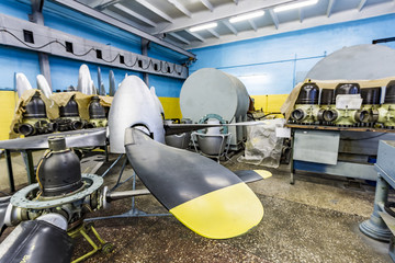 Wall Mural - Propeller of vintage military airplane in hangar. Propellers black and yellow and made of steel