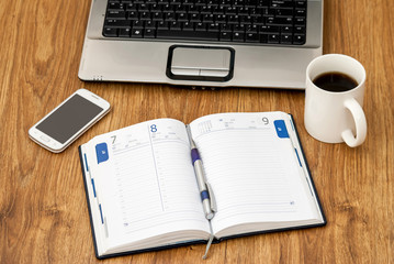 office table with notebook, cup of coffee, notebook and smartphone. copy space