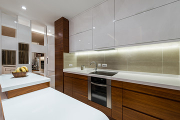 Kitchen area in specious apartment