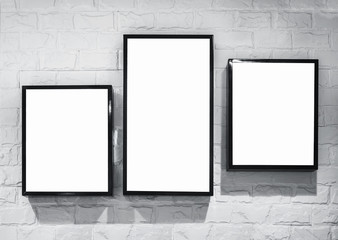 Mock up Light box frame deisign template on white brick wall