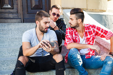 Young hipster friends having  together with smart phone
