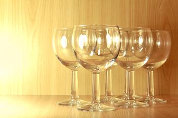 six empty wine glasses