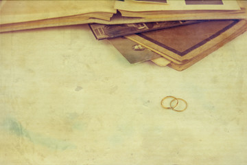 Weddings Rings with old Book and photographs isolated on White