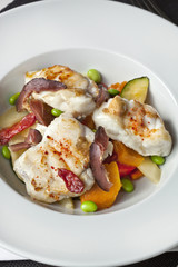Fish dish and vegetable