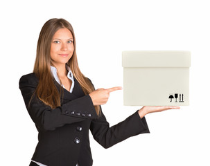 Businesslady holding and pointing at white box
