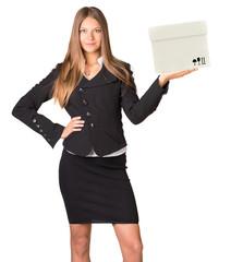 Young woman holding box and looking at camera
