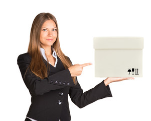 Businesslady holding and pointing at box