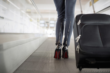Woman with suitcase in airport