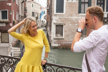 Tourist couple taking pictures in Venice
