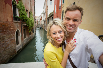 Couple taking selfie picture in Venice
