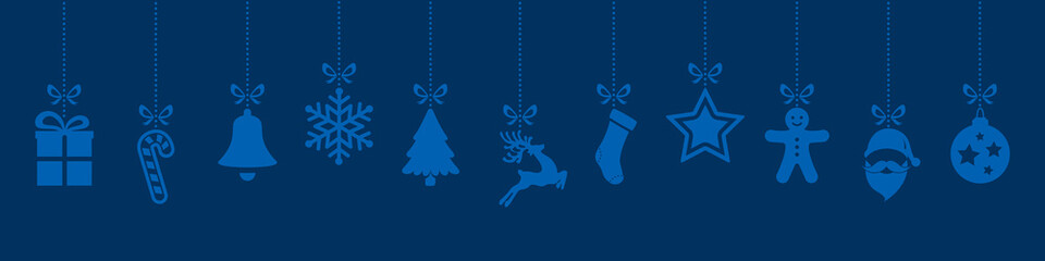 christmas ornaments hanging blue background