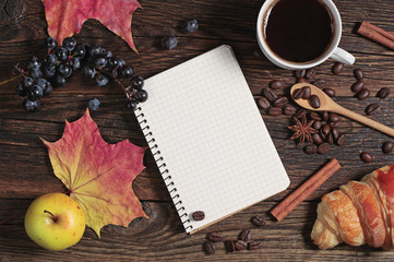 Composition with notepad, coffee and fruits