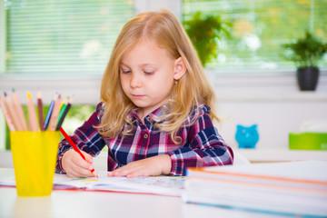 Cute girl drawing at school