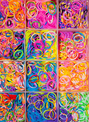 Colorful elastic bands in a box as a background.