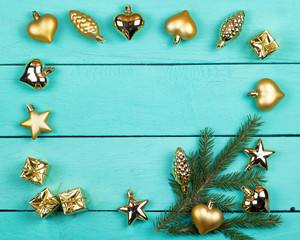 Frame from fir-tree branches and golden toys